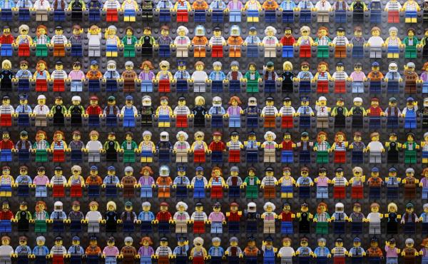 A wall of Lego minifigures is encased inside the lobby of the Legoland Hotel in Goshen, N.Y. on Aug. 6. The Danish company is pledging to remove harmful stereotypes from its products and marketing.
