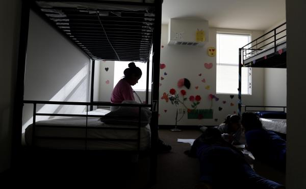 When children are held for long periods away in detention centers, such as this center for migrant children in Carrizo Springs, Texas, they may suffer psychological harm.
