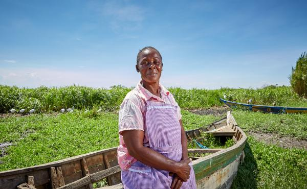 Alice Amonde sits on a boat on the village of Nduru Beach, Kenya. She is part of the group of women who have fought against the practice of transactional sex that was part of the fishing business. This photograph was taken in November 2019. This spring, f