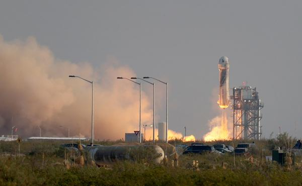 Blue Origin's New Shepard rocket lifts off from the launch pad Tuesday morning in Van Horn, Texas.