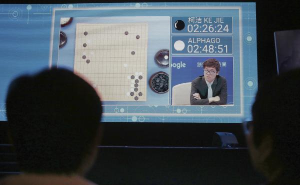 Spectators watch the world's top-ranked Go player, Ke Jie, square off against Google's artificial intelligence program, AlphaGo, during the Future of Go Summit in Wuzhen, China, on Tuesday. The program beat Ke in the first of three planned matches.