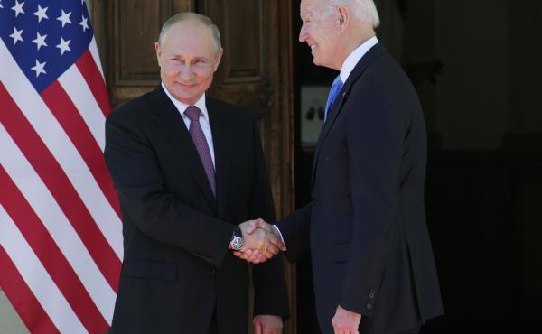 Russian President Vladimir Putin and President Joe Biden shake hands during their meeting at the 'Villa la Grange' in Geneva, Switzerland, today.