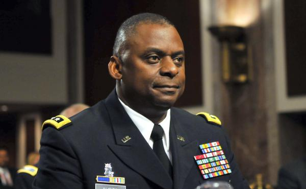 In this 2010 photo, Army Lt. Gen. Lloyd Austin appears at a Senate Armed Services Committee hearing on his  reappointment to be commander of the U.S. forces in Iraq. President-elect Joe Biden plans to nominate Austin as the first African-American to be de