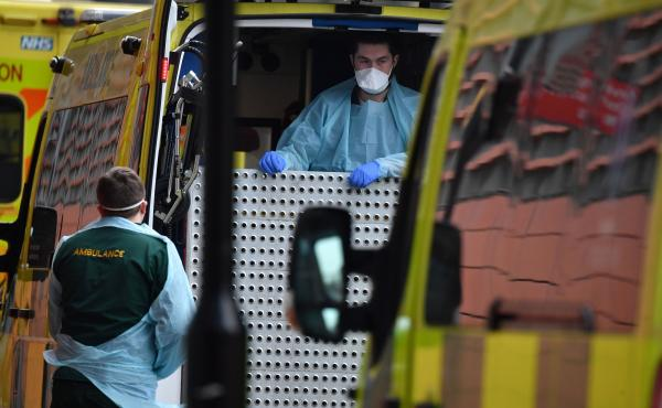 """Paramedics prepare an ambulance outside the Royal London Hospital on Friday. Mayor Sadiq Khan has declared a """"major incident,"""" warning that hospitals in the British capital could soon be overwhelmed after a surge in coronavirus infections."""