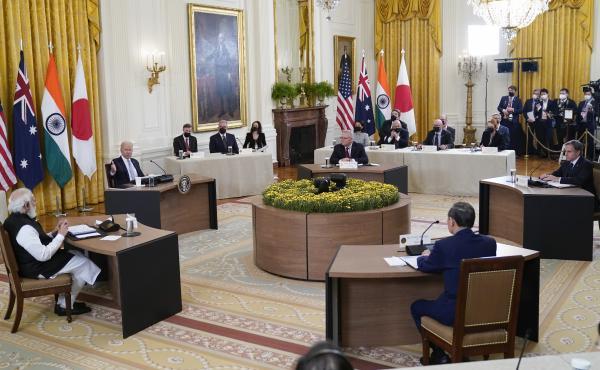 President Biden speaks during a Sept. 24 summit at the White House that included (clockwise from left) Indian Prime Minister Narendra Modi, Biden, Australian Prime Minister Scott Morrison, U.S. Secretary of State Antony Blinken and Yoshihide Suga, Japan's