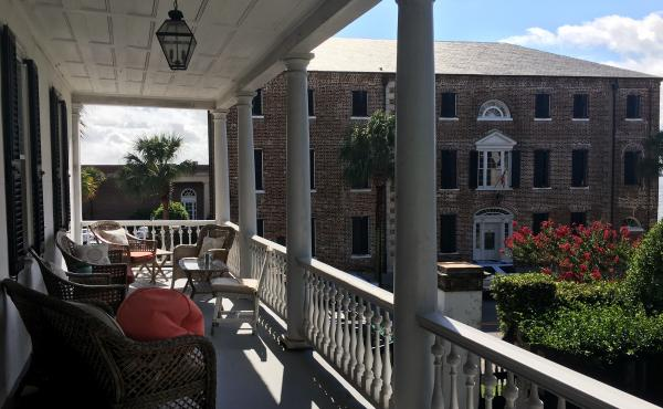 The upstairs porch of Ann Blessing's home in Charleston, S.C. has been a stop on a popular historic home tour. For the first time, visitors will tour the kitchen where enslaved people once spent most of their lives, toiling over hot fires.