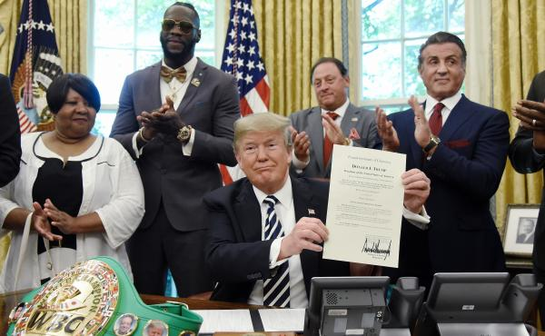 President Trump signs a posthumous pardon for boxer Jack Johnson on May 24. The White House has privately asked prisoner advocates in recent weeks for the names of more potential clemency candidates.