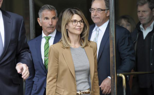 Lori Loughlin exits a courthouse in Boston last week. The actress and 15 other parents were hit with a second superseding indictment Tuesday, increasing the legal jeopardy they face for their alleged role in the college admissions cheating scandal.