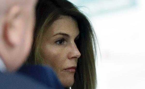 Loughlin enters a federal court hearing in the college admissions bribery case in August 2019 in Boston.