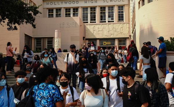 Students exit Hollywood High School after a day of school in Los Angeles.