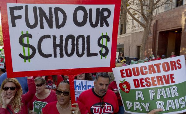 Educators march in downtown Los Angeles on Dec. 15. Negotiations between United Teachers Los Angeles and the LA Unified School District started in early 2017.