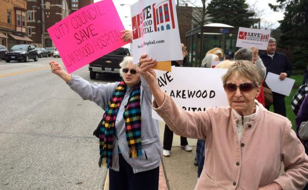 """Ann Allen (right) and Marie Birsic (left) take part in a demonstration to prevent the closure of Lakewood Hospital on Cleveland's West Side. Birsic says the neighborhood will """"go down into a ghost town"""" once the hospital is turned into an outpatient cente"""