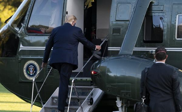 President Trump boards Marine One for a trip from the White House to Walter Reed National Military Medical Center for COVID-19 treatment in early October. Trump received Regeneron's antibody cocktail during his illness.
