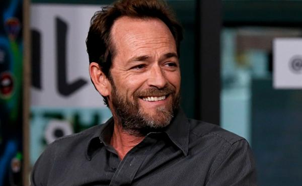 Luke Perry, seen here last October during a press appearance for the TV series Riverdale, has died following a massive stroke, his publicist said Monday.