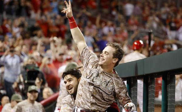 The Cincinnati Reds' Scooter Gennett (center) celebrated his big night against the St. Louis Cardinals Tuesday, when he went 5-for-5 at the plate and smashed four home runs.