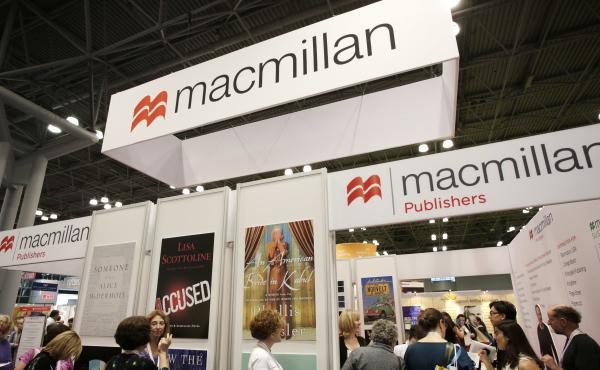 Readers wait in line at Macmillan booth at the Book Expo trade show in 2013.