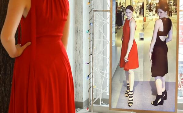 """Neiman Marcus is testing a digital """"Memory Mirror"""" that lets shoppers see how an outfit looks in back as well as displaying items they've tried on side by side."""