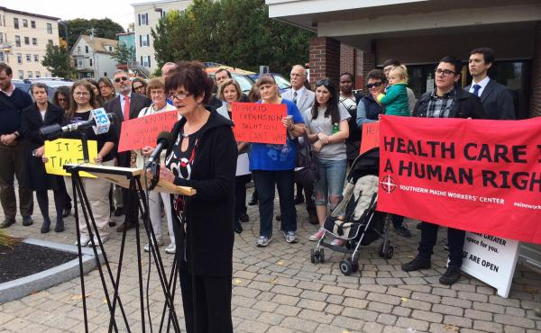 Kathleen Phelps, who lacks health insurance, speaks in favor of expanding Medicaid at a news conference in Portland, Maine on Oct. 13, 2016.