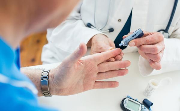 Doctor takes a sample of a patient's blood.