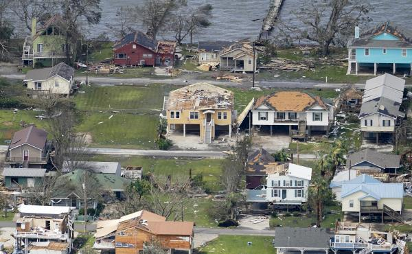 Hurricane Laura left scattered debris and damaged homes in Lake Charles, La. last week. The state has reported 15 deaths associated with the storm, with more than half of those attributed to improper use of portable generators.