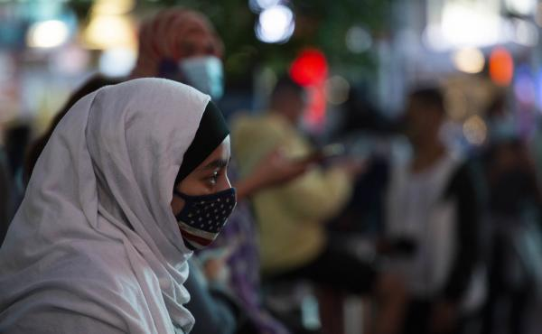 A woman wears a hijab and an American flag mask during an election celebration last month in New York's Times Square.