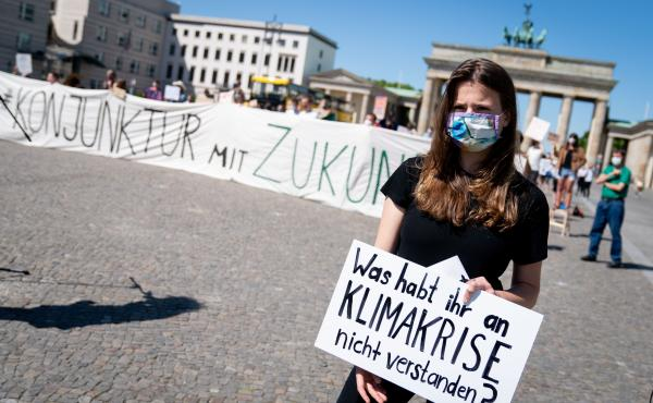 Luisa-Marie Neubauer of Fridays for Future takes part in a demonstration in front of the Brandenburg Gate in Berlin on June 2. The protest took place while government leaders discussed economic stimulus and other strategies in the fight against the corona