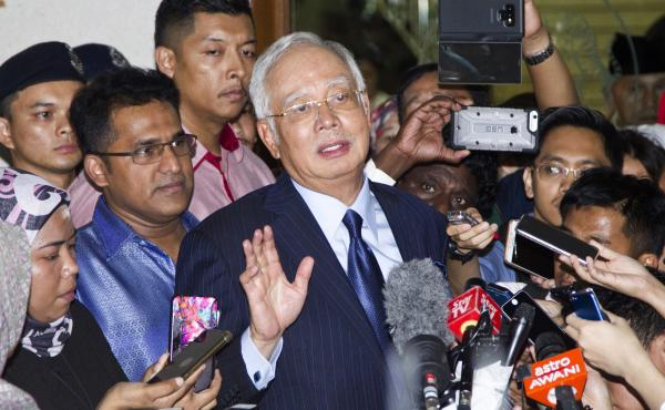 Former Prime Minister Najib Razak speaks during a press conference after being granted bail at a court hearing at Kuala Lumpur High Court in Kuala Lumpur, Malaysia, Thursday. Najib pleaded not guilty Thursday to 25 fresh charges of abuse of power and mone