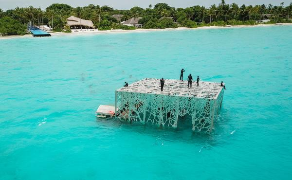 British artist Jason deCaires Taylor's Coralarium sits in waters off the Maldives.