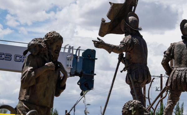 A sculpture of Juan de Onate's group of settlers colonizing New Mexico is pictured as workers for the City of Albuquerque remove a sculpture of Spanish conquistador Juan de Onate on Wednesday in Albuquerque, New Mexico. A man was shot a day before as a he