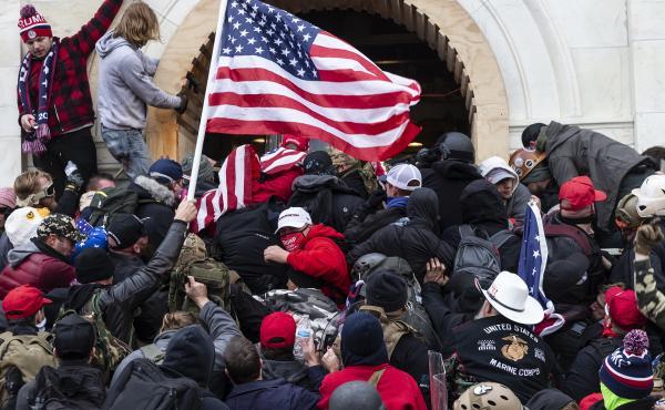 Rioters clash with police trying to enter Capitol building through the front doors. Rioters broke windows and breached the Capitol building in an attempt to overthrow the results of the 2020 election.