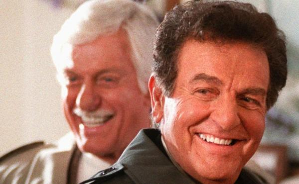 Actor Mike Connors, who starred in the TV detective show Mannix, flashes a smile after filming a scene with Dick Van Dyke, for an episode of Diagnosis Murder in 1997. The show centered around an unsolved mystery from Mannix, with Connors returning to his