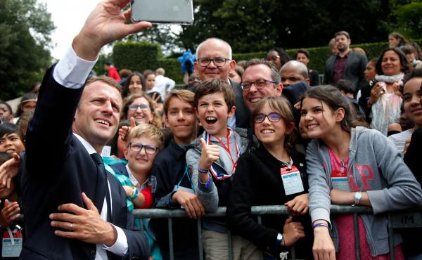 While French President, Emmanuel Macron, took selfies with some members of the crowd, he scolded one teen at the Mont Valerien National Memorial in Suresnes.