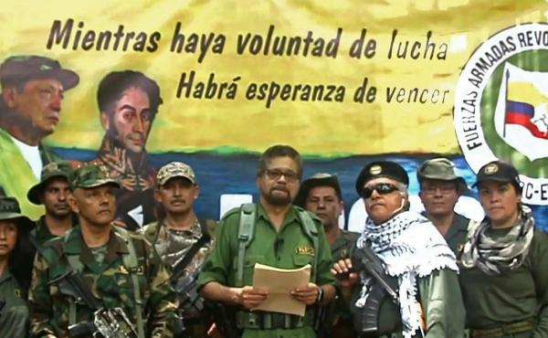 In an image from a YouTube video released on Aug. 29, 2019, shows Former senior commander Iván Márquez (center) and fugitive rebel colleague, Jesús Santrich (wearing sunglasses), of the Revolutionary Armed Forces of Colombia at an undisclosed location