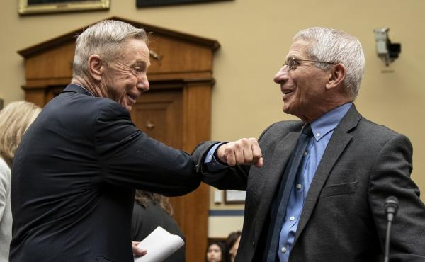Before there were masks, there were elbow bumps. Rep. Stephen Lynch, D-Mass., and Dr. Anthony Fauci greet each other before a House Oversight and Reform Committee hearing on March 11, 2020.
