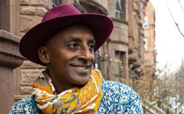 """Chef Marcus Samuelsson's new book is called The Rise: Black Cooks and the Soul of American Food. """"Dressing has always been part of an African identity, but also a sad journey in American history,"""" Samuelsson says. """"As Black men, we had to dress up. ... If"""