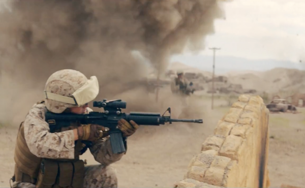 A screenshot shows a new TV ad recruiting for the Marines. It's the first to focus on a woman in a combat role.