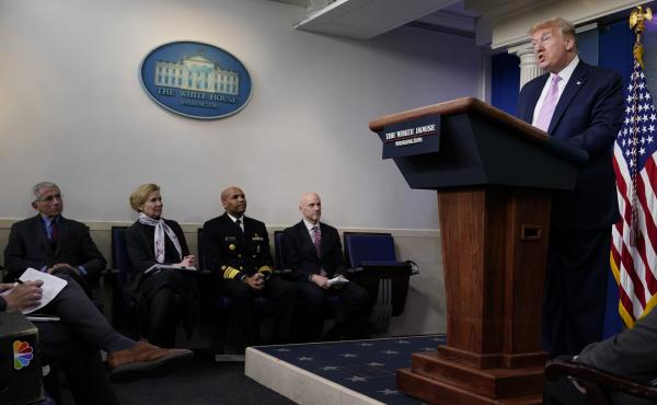 President Donald Trump speaks during a coronavirus task force briefing at the White Houseon Friday. Seated from left, Director of the National Institute of Allergy and Infectious Diseases Dr. Anthony Fauci, White House coronavirus response coordinator Dr.