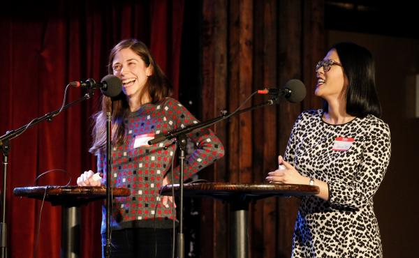 Contestants Katie Edwards and Danielle Mebert play a game on Ask Me Another at the Bell House in Brooklyn, New York.