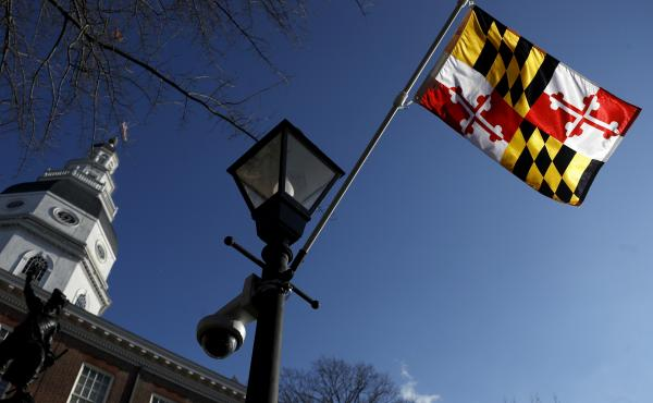 A Maryland state flag waves near the Statehouse in Annapolis. Maryland has decided to drop a state song that originated during the Civil War and alludes to Abraham Lincoln as a tyrant and a despot.