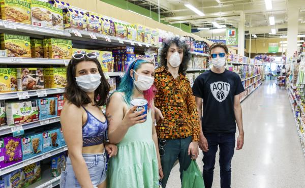 Increasingly, many people in the U.S., like these teens in a Miami grocery story in August, now routinely wear face masks in public to help stop COVID-19's spread. But social distancing and other public health measures have been slower to catch on, especi