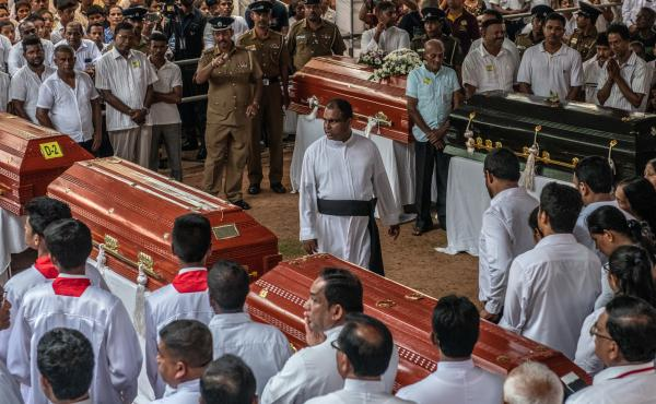 Mourners gather during a mass funeral at St. Sebastian's Church in Negombo on Tuesday, following a series of coordinated bombings of churches and hotels in Sri Lanka on Easter Sunday.
