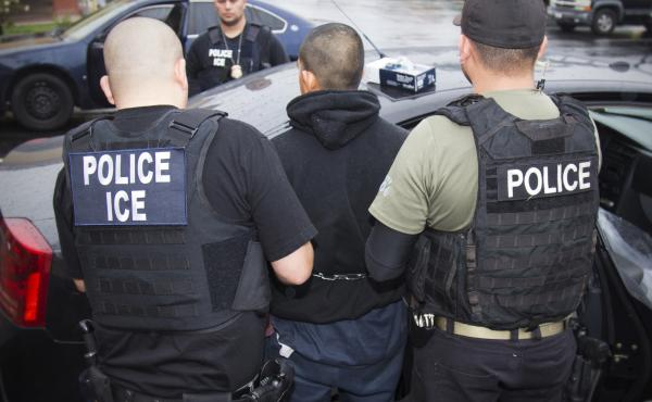 """In this February photo released by U.S. Immigration and Customs Enforcement, agents arrest foreign nationals. According to a Massachusetts Supreme Judicial Court ruling Monday, local law enforcement cannot honor ICE """"detainers,"""" which request that a perso"""