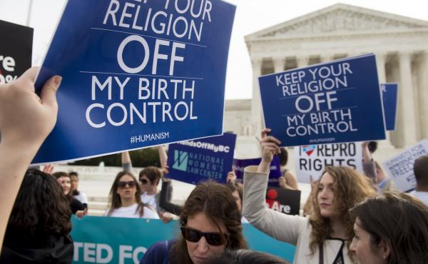 Supporters of women's health rally outside the Supreme Court in Washington, D.C., March 23, 2016, as the Court hears oral arguments in seven cases dealing with religious organizations that want to ban contraceptives from their health insurance policies on