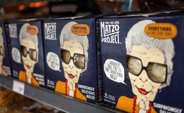 "Boxes of ""Surprisingly Delicious Matzo"" made by The Matzo Project line the shelves of Glen's Garden Market in Washington, D.C."