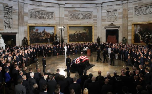 The flag-draped casket of Sen. John McCain arrives inside the Rotunda of the U.S. Capitol on Friday.