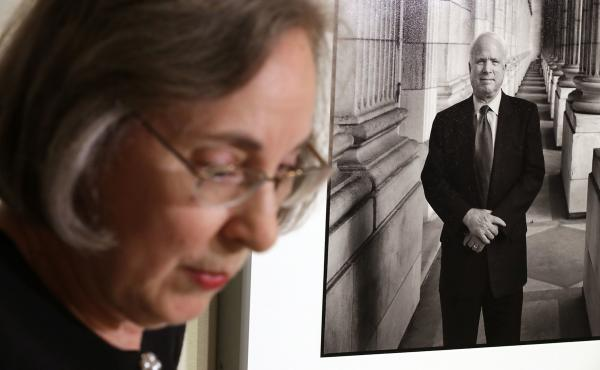 Smithsonian National Portrait Gallery curator Ann Shumard talks about a photograph of Sen. John McCain, R-Ariz., that was displayed at the gallery on Monday. The former presidential candidate died Saturday of brain cancer at the age of 81. This is the fir