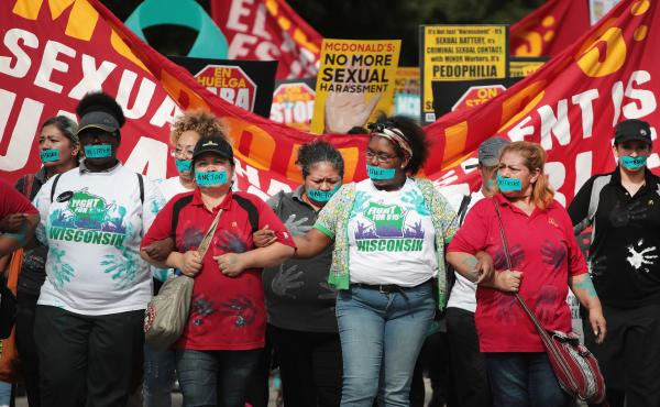 McDonald's workers are joined by other activists as they march toward the company's Chicago headquarters to protest sexual harassment at the fast-food chain's restaurants on Sept. 18.