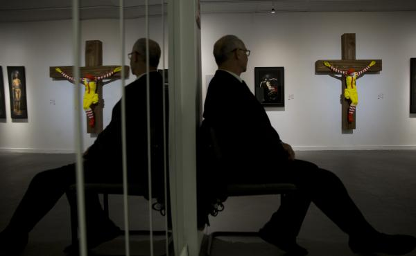 """The sculpture, known as McJesus, was created by Finnish artist Jani Leinonen and displayed as part of the Haifa Museum of Art's """"Sacred Goods"""" exhibition in Israel. The piece, seen on display in the museum Monday, prompted vehement pushback from Christian"""