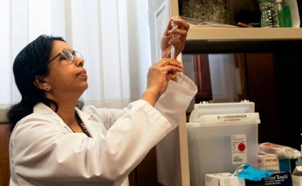 A nurse prepares the measles, mumps and rubella vaccine at the Rockland County Health Department in Haverstraw, Rockland County, New York. Several measles outbreaks in New York state are contributing to this year's unusually high measles rates.