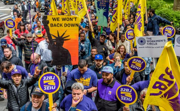Cashiers, cooks, delivery people, fast-food workers and their supporters rallied outside New York City Hall in 2017. Their influential union, the Service Employees International Union, also includes about half a million home health aides.